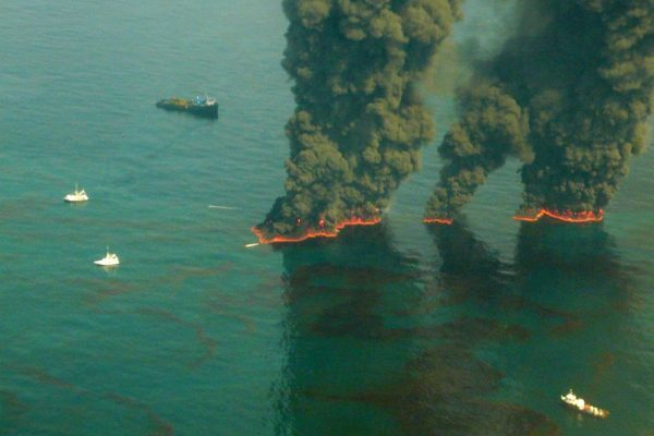 Controlled burn of oil on water in the gulf.